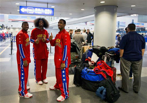 Members of the Harlem Globetrotters basketball team gesture as they prepare to check in with former NBA star Dennis Rodman, not in the photo, at the departure hall of Beijing Capital International Airport in Beijing Tuesday, Feb. 26, 2013. Dennis Rodman, and three members of the Harlem Globetrotters basketball team, a VICE correspondent and a production crew from the company are visiting North Korea to shoot footage for a new TV show set to air on HBO in early April, VICE told The Associated Press in an exclusive interview before the group&#39;s departure from Beijing. &#40;AP Photo&#47;Andy Wong&#41; <span class=meta>(AP Photo&#47; Andy Wong)</span>