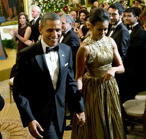 President Barack Obama and first lady Michelle Obama leaves a reception in honor of the 2012 Kennedy Center Honors recipients, in the East Room of the White House in Washington, Sunday, Dec. 2, 2012. At the back left is Caroline Kennedy. &#40;AP Photo&#47;Manuel Balce Ceneta&#41; <span class=meta>(AP Photo&#47; Manuel Balce Ceneta)</span>