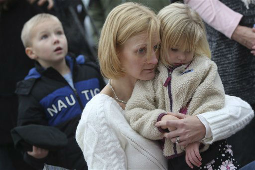 "<div class=""meta ""><span class=""caption-text "">Barbara Wells of Shelton, Conn., holds her daughter Olivia, 3, as she pays her respects Monday, Dec. 17, 2012 at one of the makeshift memorials for the victims of the Sandy Hook Elementary School shooting in Newtown, Conn. (AP Photo/Mary Altaffer) (AP Photo/ Mary Altaffer)</span></div>"