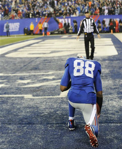 New York Giants wide receiver Hakeem Nicks &#40;88&#41; kneels in the end zone after scoring on a 25-yard touchdown pass during the second half of an NFL football game against the New Orleans Saints Sunday, Dec. 9, 2012, in East Rutherford, N.J. &#40;AP Photo&#47;Bill Kostroun&#41; <span class=meta>(AP Photo&#47; Bill Kostroun)</span>