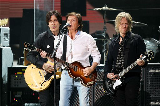 This image released by Starpix shows Paul McCartney, center, at the 12-12-12 The Concert for Sandy Relief at Madison Square Garden in New York on Wednesday, Dec. 12, 2012. Proceeds from the show will be distributed through the Robin Hood Foundation. &#40;AP Photo&#47;Starpix, Dave Allocca&#41; <span class=meta>(AP Photo&#47; Dave Allocca)</span>