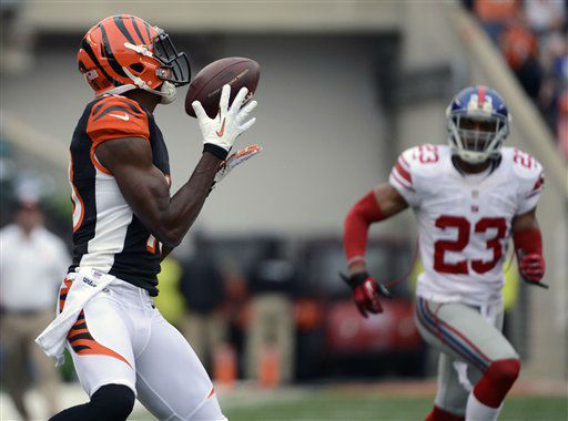 Cincinnati Bengals wide receiver A.J. Green, left, catches a 56-yard touchdown pass against New York Giants cornerback Corey Webster &#40;23&#41; in the first half of an NFL football game on Sunday, Nov. 11, 2012, in Cincinnati. &#40;AP Photo&#47;Michael Keating&#41; <span class=meta>(AP Photo&#47; Michael Keating)</span>