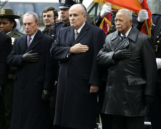 Mayor Michael Bloomberg, left, and former Mayors Rudolph Giuliani, center, and David Dinkins put their hands over their hearts as a casket containing the body of former New York City Mayor Ed Koch leaves a synagogue after his funeral in New York, Monday, Feb. 4, 2013. Koch was remembered as the quintessential New Yorker during a funeral that frequently elicited laughter, recalling his famous one-liners and amusing antics in the public eye. &#40;AP Photo&#47;Seth Wenig&#41; <span class=meta>(AP Photo&#47; Seth Wenig)</span>