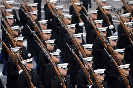 "<div class=""meta ""><span class=""caption-text "">Members of the United States Marine Corps march during the 57th Presidential Inaugural Parade on Pennsylvania Avenue, Monday, Jan. 21, 2013 in Washington. Thousands marched during the 57th Presidential Inauguration parade after the ceremonial swearing-in of President Barack Obama. (AP Photo/Alex Brandon) (AP Photo/ Alex Brandon)</span></div>"