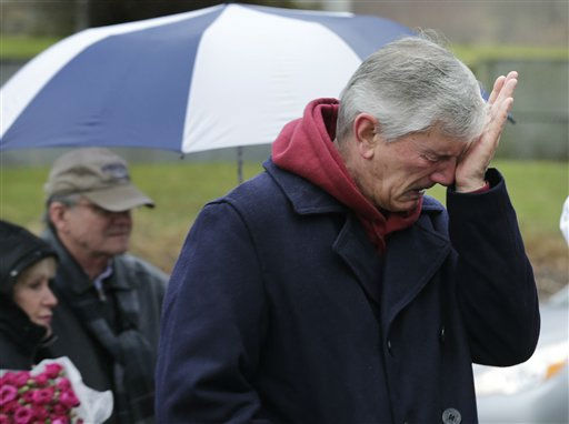 "<div class=""meta ""><span class=""caption-text "">A man reacts at the site of a makeshift memorial for school shooting victims at the village of Sandy Hook in Newtown, Conn., Sunday, Dec. 16, 2012. A gunman opened fire at Sandy Hook Elementary School in the town, killing 26 people, including 20 children before killing himself on Friday. (AP Photo/Charles Krupa) (AP Photo/ Charles Krupa)</span></div>"