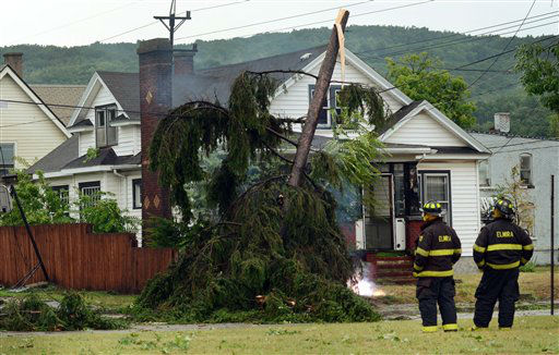 "<div class=""meta ""><span class=""caption-text "">Elmira N.Y., firefighters watch an electric wire fire closely after a possible tornado struck the area, Thursday, July 26, 2012, in Elmira N.Y. Power lines and trees were toppled and hospitals were placed on disaster alert but there were no immediate reports of injuries after a possible tornado hit the city of Elmira Thursday afternoon, Chemung County Office of Fire and Emergency Management spokeswoman Karen Miner said.(AP Photo/Heather Ainsworth) (AP Photo/ Heather Ainsworth)</span></div>"