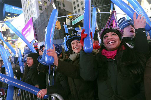 Jackie Soto, right, and Nicole Soto, of Cherry Hill, N.J. dance during one of the musical performances at the Times Square New Year&#39;s celebration Monday, Dec. 31, 2012 in New York. &#40;AP Photo&#47;Mary Altaffer&#41; <span class=meta>(AP Photo&#47; Mary Altaffer)</span>