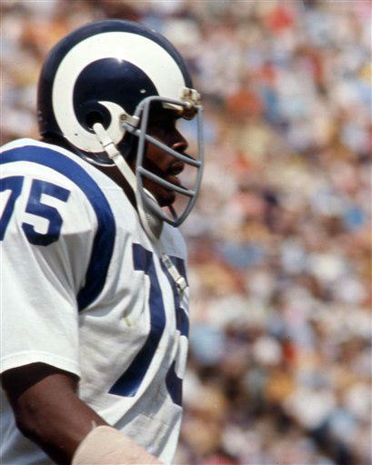 "<div class=""meta ""><span class=""caption-text "">Los Angeles Rams Hall of Fame defensive end David ""Deacon"" Jones (75) leaves the field during game against the Atlanta Falcons in Los Angeles, Sept. 26, 1971. The Rams and Falcons tied 20-20 at the Los Angeles Coliseum.  (AP Photo/NFL Photos) (AP Photo/ Uncredited)</span></div>"