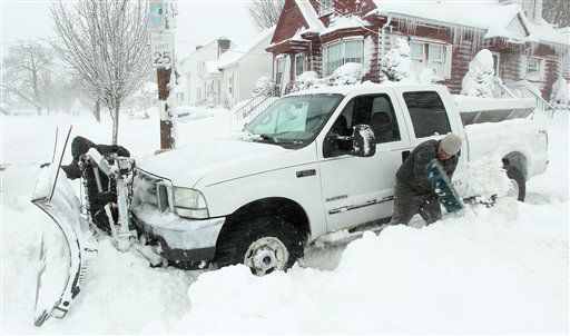 "<div class=""meta ""><span class=""caption-text "">Michael Gelardi, right, and Larry Rose, left, attempt to dig out their snow plow after it got stuck in deep snow Saturday, Feb. 9, 2013, in Providence, R.I.  A howling storm across the Northeast left the New York-to-Boston corridor shrouded in 1 to 3 feet of snow Saturday, stranding motorists on highways overnight and piling up drifts so high that some homeowners couldn't get their doors open. More than 650,000 homes and businesses were left without electricity.(AP Photo/Stew Milne) (AP Photo/ Stew Milne)</span></div>"