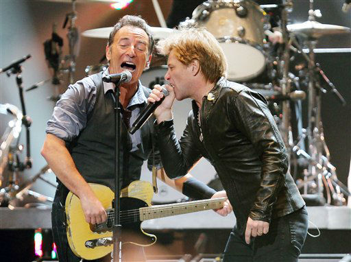 This image released by Starpix shows Bruce Springsteen, left, and Jon Bon Jovi performing at the 12-12-12 The Concert for Sandy Relief at Madison Square Garden in New York on Wednesday, Dec. 12, 2012. Proceeds from the show will be distributed through the Robin Hood Foundation. &#40;AP Photo&#47;Starpix, Dave Allocca&#41; <span class=meta>(AP Photo&#47; Dave Allocca)</span>