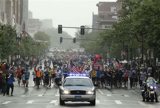 "<div class=""meta ""><span class=""caption-text "">Runners who were unable to finish the Boston Marathon on April 15 because of the bombings head toward the finish line on Boylston Street after the city allowed them to finish the last mile of the race in Boston, Saturday, May 25, 2013. (AP Photo/Winslow Townson) (AP Photo/ Winslow Townson)</span></div>"