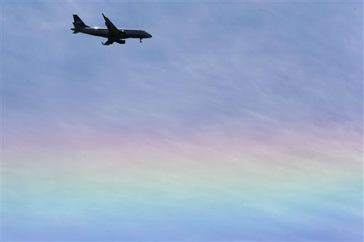 An US Airways jet flies over a rainbow as descends to land Tuesday, May 14, 2013, in Philadelphia. &#40;AP Photo&#47;Matt Rourke&#41; <span class=meta>(AP Photo&#47; Matt Rourke)</span>