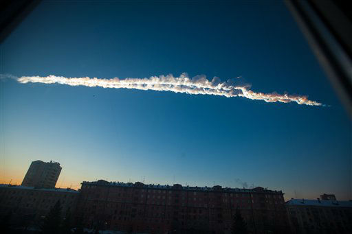 In this photo provided by Chelyabinsk.ru a meteorite contrail is seen over Chelyabinsk on Friday, Feb. 15, 2013. A meteor streaked across the sky of Russia?s Ural Mountains on Friday morning, causing sharp explosions and reportedly injuring around 100 people, including many hurt by broken glass. &#40;AP Photo&#47;Chelyabinsk.ru&#41; <span class=meta>(AP Photo&#47; Yekaterina Pustynnikova)</span>