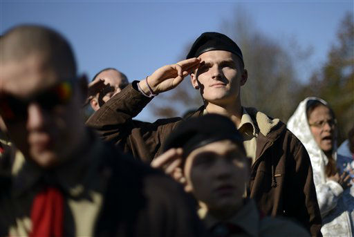 Boy Scout Michael Demanche, of Mashpee, Mass., salutes the flag during a ceremony held at the National Cemetery in Bourne, Mass., Saturday, Nov. 10, 2012. Following the ceremony, Demanche joined hundreds of volunteers in placing thousands of American flags at the graves of deceased veterans in advance of Veterans Day. &#40;AP Photo&#47;Gretchen Ertl&#41; <span class=meta>(AP Photo&#47; Gretchen Ertl)</span>