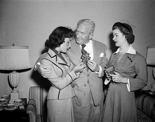 Movie stars Elizabeth Taylor , Spencer Tracy and Joan Bennett at a news conference in Washington D.C., February 24, 1951.      They are in Washington to make a radio broadcast of &#34;Father of the Bride&#34; in which they appeared in the movie version.   &#40;AP Photo&#47;Henry Burroughs&#41; <span class=meta>(AP Photo&#47; Henry Burroughs)</span>
