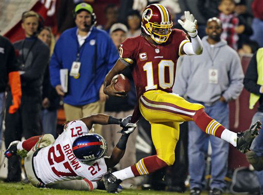 "<div class=""meta ""><span class=""caption-text "">Washington Redskins quarterback Robert Griffin III (10) is pulled down by New York Giants strong safety Stevie Brown (27) during the second half of an NFL football game in Landover, Md., Monday, Dec. 3, 2012. (AP Photo/Evan Vucci) (AP Photo/ Evan Vucci)</span></div>"