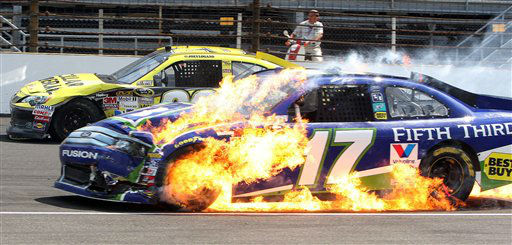 "<div class=""meta ""><span class=""caption-text "">Matt Kenseth's car catches fire after an accident during the NASCAR Sprint Cup Series Brickyard 400 auto race at Indianapolis Motor Speedway in Indianapolis, Sunday, July 29, 2012. (AP Photo/Ron Sanders) (AP Photo/ Ron Sanders)</span></div>"