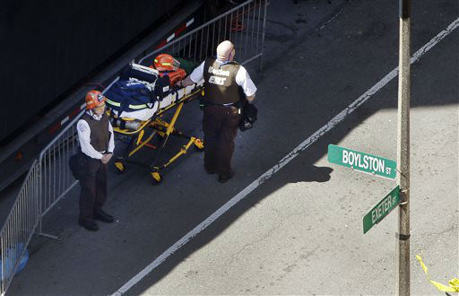 "<div class=""meta ""><span class=""caption-text "">Boston EMTs stand at the ready while investigators examine the scenes of the bombings on Boylston Street in Boston Tuesday, April 16, 2013 near the finish line of the Boston Marathon.  Monday two blasts killed at least three and injured over 170 people. (AP Photo/Elise Amendola) (AP Photo/ Elise Amendola)</span></div>"