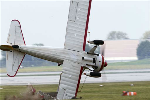 ED&#39;S NOTE: GRAPHIC CONTENT - A stunt plane with a wing walker crashes during a performance at the Vectren Air Show, Saturday, June 22, 2013, in Dayton, Ohio. The crash killed the pilot and the wing walker instantly, authorities said. &#40;AP Photo&#47;Thanh V Tran&#41; MANDATORY CREDIT DOMESTIC USE ONLY. FOR INTERNATIONAL USE CONTACT AP IMAGES <span class=meta>(AP Photo&#47; Thanh V Tran)</span>