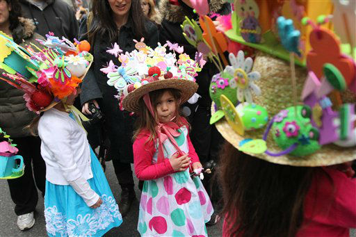 Dressed for the occasion, Alessandra Macchia-Barba, 4, of Newark, N.J., center, and others make their way along New York&#39;s Fifth Avenue as they take part in the Easter Parade Sunday March 31, 2013. <span class=meta>(AP Photo&#47; Tina Fineberg)</span>