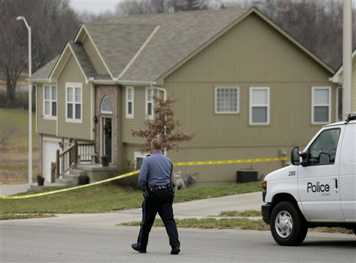 A police officer walks to an Independence, Mo., house house where police say Kansas City Chiefs linebacker Jovan Belcher fatally shot his girlfriend before driving to the NFL football team&#39;s training facility and shooting himself, Saturday, Dec. 1, 2012. &#40;AP Photo&#47;Charlie Riedel&#41; <span class=meta>(AP Photo&#47; Charlie Riedel)</span>