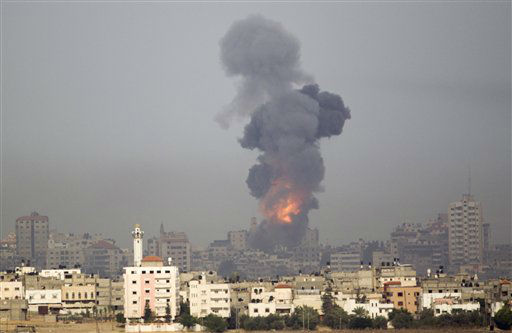 "<div class=""meta ""><span class=""caption-text "">Explosion and smoke rise following an Israeli strike in Gaza, seen from the Israel Gaza Border, southern Israel, Saturday, Nov. 17, 2012. Israel bombarded the Hamas-ruled Gaza Strip with more than 180 airstrikes early Saturday, the military said, widening a blistering assault on militant operations to include the prime minister's headquarters, a police compound and a vast network of smuggling tunnels. The new attacks followed an unprecedented rocket strike aimed at the contested holy city of Jerusalem that raised the stakes in Israel's violent confrontation with Palestinian militants. (AP Photo/Ariel Schalit) (AP Photo/ Ariel Schalit)</span></div>"