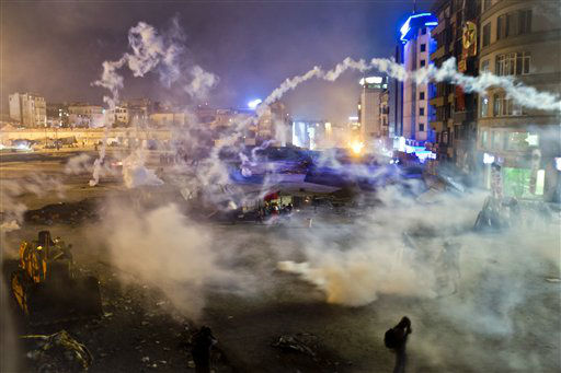 "<div class=""meta image-caption""><div class=""origin-logo origin-image ""><span></span></div><span class=""caption-text"">Taksim Square is flooded by tear gas as clashes between protesters and riot police continue into the night in Istanbul Tuesday, June 11, 2013. Hundreds of police in riot gear forced through barricades in the square early Tuesday, pushing many of the protesters who had occupied the square for more than a week into a nearby park. (AP Photo/Vadim Ghirda)</span></div>"