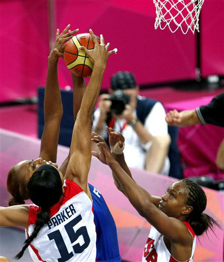 United States&#39; Candace Parker &#40;15&#41; makes a block on France&#39;s Sandrine Gruda, center, as Tamika Catchings helps defend during a women&#39;s gold medal basketball game at the 2012 Summer Olympics, Saturday, Aug. 11, 2012, in London. &#40;AP Photo&#47;Julio Cortez&#41; <span class=meta>(AP Photo&#47; Julio Cortez)</span>