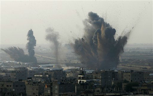 Smoke rises following an Israeli attack on smuggling tunnels on the border between Egypt and Rafah, southern Gaza Strip, Monday, Nov. 19, 2012. &#40;AP Photo&#47;Eyad Baba&#41; <span class=meta>(AP Photo&#47; Eyad Baba)</span>