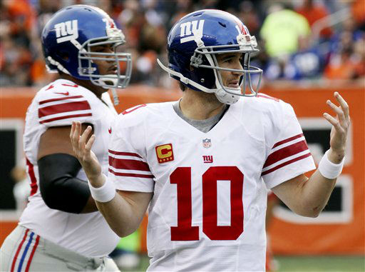 New York Giants quarterback Eli Manning &#40;10&#41; holds up his hands after having a pass tipped for an interception in the second half of an NFL football game against the Cincinnati Bengals, Sunday, Nov. 11, 2012, in Cincinnati. &#40;AP Photo&#47;Tom Uhlman&#41; <span class=meta>(AP Photo&#47; Tom Uhlman)</span>