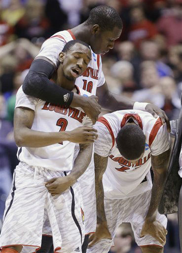 Louisville&#39;s Russ Smith &#40;2&#41;, Gorgui Dieng &#40;10&#41; and Chane Behanan react to guard Kevin Ware&#39;s injury during the first half of the Midwest Regional final against Duke in the NCAA college basketball tournament, Sunday, March 31, 2013, in Indianapolis. &#40;AP Photo&#47;Michael Conroy&#41; <span class=meta>(AP Photo&#47; Michael Conroy)</span>