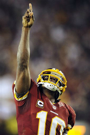 Washington Redskins quarterback Robert Griffin III points skyward after throwing a touchdown pass to wide receiver Pierre Garcon during the second half of an NFL football game against the New York Giants in Landover, Md., Monday, Dec. 3, 2012. &#40;AP Photo&#47;Nick Wass&#41; <span class=meta>(AP Photo&#47; Nick Wass)</span>