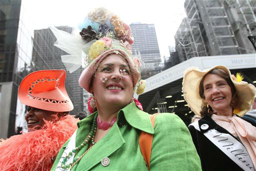 Dressed for the occasion, Anne DePasquale, of New York, center, and others pose for photographs on New York&#39;s Fifth Avenue as they take part in the Easter Parade, Sunday, March 31, 2013. &#40;AP Photo&#47;Tina Fineberg&#41; <span class=meta>(AP Photo&#47; Tina Fineberg)</span>