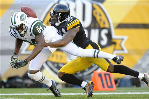 Pittsburgh Steelers free safety Ryan Clark &#40;25&#41; holds on to New York Jets wide receiver Stephen Hill &#40;84&#41; after breaking up a pass in the second quarter of an NFL football game, Sunday, Sept. 16, 2012, in Pittsburgh. &#40;AP Photo&#47;Don Wright&#41; <span class=meta>(AP Photo&#47; Don Wright)</span>