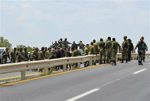 Mexican army soldiers arrive to aid after an explosion ripped through a gas pipeline distribution center in Reynosa, Mexico near Mexico&#39;s border with the United States, Tuesday Sept. 18, 2012. Mexico&#39;s state-owned oil company, Petroleos Mexicanos, also known as Pemex said the fire had been extinguished and the pipeline had been shut off but ten people were killed during the incident. &#40;AP Photo&#47;El Manana de Reynosa&#41; <span class=meta>(AP Photo&#47; El Manana de Reynosa)</span>