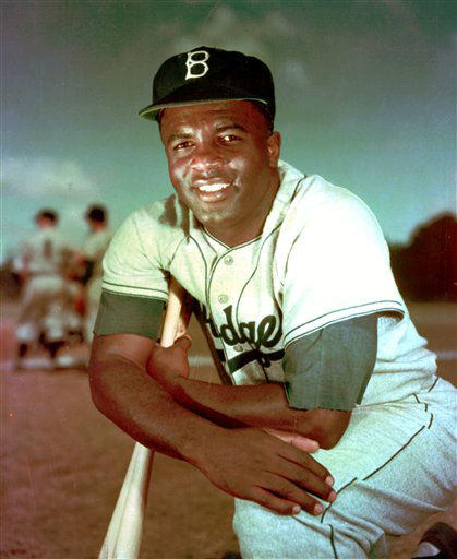 "<div class=""meta image-caption""><div class=""origin-logo origin-image ""><span></span></div><span class=""caption-text"">FILE - Brooklyn Dodgers baseball player Jackie Robinson poses in 1952. Kansas City's Negro Leagues Baseball Museum is hosting an advance screening of an upcoming movie about Robinson, who broke major league baseball's color barrier. Thomas Butch of the financial firm Waddell and Reed announced Wednesday, March 20, 2013 that actors Harrison Ford and Andre Holland will be among those appearing at an April 11 screening of ""42.""   (AP Photo/File) (AP Photo/ DG)</span></div>"
