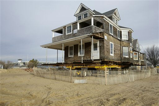 A damaged bayside home rests on a wheeled frame waiting to be raised in Mantoloking, N.J., Friday, Feb. 22, 2013. One of the hardest-hit Jersey shore communities, Mantoloking, will allow its residents to begin moving back home Friday. It is the last shore town to do so. It&#39;s not a mad rush. The winter population of the barrier island community totals only about 100 and many homes are not yet livable. And some people have no home to come back to. Sixty or so houses disappeared completely and hundreds more were so badly damaged they&#39;ll probably need to be demolished. &#40;AP Photo&#47;Mel Evans&#41; <span class=meta>(AP Photo&#47; Mel Evans)</span>
