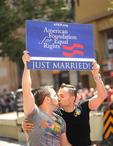Proposition 8 plaintiffs Paul Katami, right, and Jeff Zarrillo kiss while riding in San Francisco&#39;s 43rd annual Gay Pride parade Sunday, June 30, 2013. The couple wed on Friday after a U.S. Supreme Court decision cleared the way for same-sex marriages in California. &#40;AP Photo&#47;Noah Berger&#41; <span class=meta>(AP Photo&#47; Noah Berger)</span>