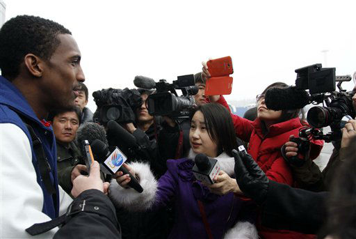 Bull Bullard, left, a member of the Harlem Globetrotters, is mobbed by journalists upon arrival at Pyongyang Airport, North Korea, Tuesday, Feb. 26, 2013. Flamboyant former NBA star Dennis Rodman known as &#34;The Worm&#34; arrived with three members of the basketball team, a VICE correspondent and a production crew from the company in Pyongyang, becoming an unlikely ambassador for sports diplomacy at a time of heightened tensions between the U.S. and North Korea. &#40;AP Photo&#47;Kim Kwang Hyon&#41; <span class=meta>(AP Photo&#47; Kim Kwang Hyon)</span>