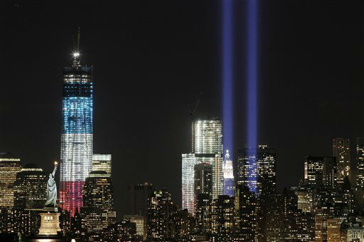 "<div class=""meta ""><span class=""caption-text "">The Tribute in Light shines above the World Trade Center and the Statue of Liberty, left, Monday, Sept. 10, 2012, as seen from Bayonne, N.J. Tuesday will mark the eleventh anniversary of the terrorist attacks of Sept. 11, 2001.  The tallest tower is 1 World Trade Center, now up to 105 floors. In the center is 4 World Trade Center. (AP Photo/Mark Lennihan) (AP Photo/ Mark Lennihan)</span></div>"