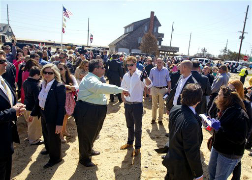 N.J. Gov. Chris Christie Britain&#39;s  Prince Harry the area where the ocean met Barnegat Bay, cutting the barrier island borough of Mantoloking, N.J.  into slices during a tour of the damaged neighborhood hit by Superstorm Sandy, Tuesday, May 14, 2013, in Mantoloking, N.J.  Prince Harry began a tour  of New Jersey?s storm-damaged coastline, inspecting dune construction, walking past destroyed homes and shaking hands with police and other emergency workers.  New Jersey sustained about &#36;37 billion worth of damage from the storm.  &#40;AP Photo&#47;The Star-Ledger, Andrew Mills, Pool&#41; <span class=meta>(AP Photo&#47; Andy,Mills)</span>