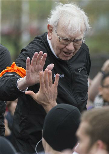 "<div class=""meta ""><span class=""caption-text "">Investor Warren Buffett high-fives a participant in a 5K run and walk organized by the Brooks Running Company, a Berkshire Hathaway subsidiary, in Omaha, Neb., Sunday, May 5, 2013. The Berkshire Hathaway shareholders meeting is being held this weekend in Omaha. (AP Photo/Nati Harnik) (AP Photo/ Nati Harnik)</span></div>"
