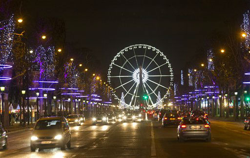 The traffic moves along the Champs Elysees looking towards the Place de la Concorde, Thursday, Dec 6, 2012 in Paris. Trees are lit - along with a big wheel - in the Tuileries gardens for Christmas.   &#40;AP Photo&#47; Jacques Brinon&#41; <span class=meta>(AP Photo&#47; Jacques Brinon)</span>