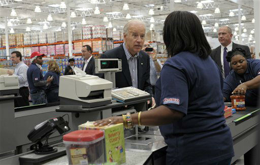 Vice President Joe Biden checks out after shopping at Costco in Washington, Thursday, Nov. 29, 2012. Biden went shopping for presents and to highlight the importance of renewing middle-class tax cuts so families and businesses have more certainty at this critical time for our economy. &#40;AP Photo&#47;Susan Walsh&#41; <span class=meta>(AP Photo&#47; Susan Walsh)</span>