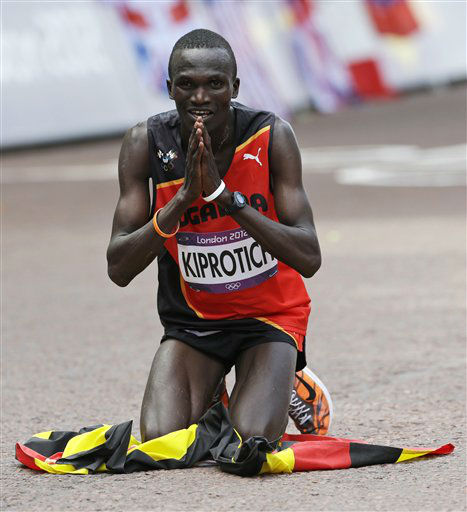 "<div class=""meta ""><span class=""caption-text "">Uganda's Stephen Kiprotich celebrates after crossing the finish line to win gold in the men's marathon at the 2012 Summer Olympics Sunday, Aug. 12, 2012 in London. (AP Photo/Anja Niedringhaus) (AP Photo/ Anja Niedringhaus)</span></div>"