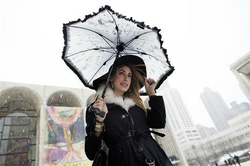Lauren Rae Levy, of Manhattan, stands outside the Metropolitan Opera House in the snow at Lincoln Center during Fashion Week, Friday, Feb. 8, 2013, in New York. Snow began falling across the Northeast on Friday, ushering in what was predicted to be a huge, possibly historic blizzard and sending residents scurrying to stock up on food and gas up their cars. &#40;AP Photo&#47;John Minchillo&#41; <span class=meta>(AP Photo&#47; John Minchillo)</span>
