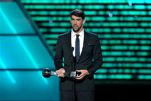 Michael Phelps accepts the award for best record-breaking performance at the ESPY Awards on Wednesday, July 17, 2013, at Nokia Theater in Los Angeles. &#40;Photo by John Shearer&#47;Invision&#47;AP&#41; <span class=meta>(Photo&#47;John Shearer)</span>