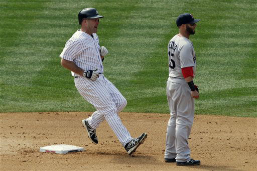 New York Yankees&#39; Kevin Youkilis arrives at second with a double as Boston Red Sox second baseman Dustin Pedroia waits for the throw in the fourth inning of a baseball game at Yankee Stadium, Monday, April 1, 2013 in New York. &#40;AP Photo&#47;Mark Lennihan&#41; <span class=meta>(AP Photo&#47; Mark Lennihan)</span>