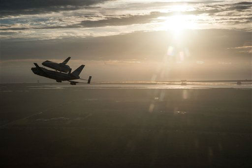 "<div class=""meta image-caption""><div class=""origin-logo origin-image ""><span></span></div><span class=""caption-text"">In this image provided by NASA the Space Shuttle Endeavour is ferried by NASA's Shuttle Carrier Aircraft (SCA) over the Kennedy Space Center in the early morning hours of Sept. 19, 2012 as it departs for California. Endeavour and the Shuttle Carrier Aircraft are in Houston after leaving Kennedy Space Center Wednesday. The ferry flight continues at dawn Thursday, heading to NASA Dryden, then on to Los Angeles Friday. This is the last flight for a space shuttle.  (AP Photo/Robert Markowitz, NASA) (AP Photo/ ROBERT MARKOWITZ Robert Markowitz - NASA - JSC)</span></div>"