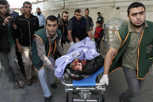 Palestinian medics wheel the body of Mohammad Al-Lolahi, 26, a Hamas militant, at Al Najar hospital following an Israeli air strike on a group of Hamas militants in Rafah southern Gaza Strip, Saturday, Nov. 17, 2012. A Palestinian official said four Hamas militants were killed during an Israeli air strike Saturday. &#40;AP Photo&#47;Hatem Omar&#41; <span class=meta>(AP Photo&#47; Hatem Omar)</span>